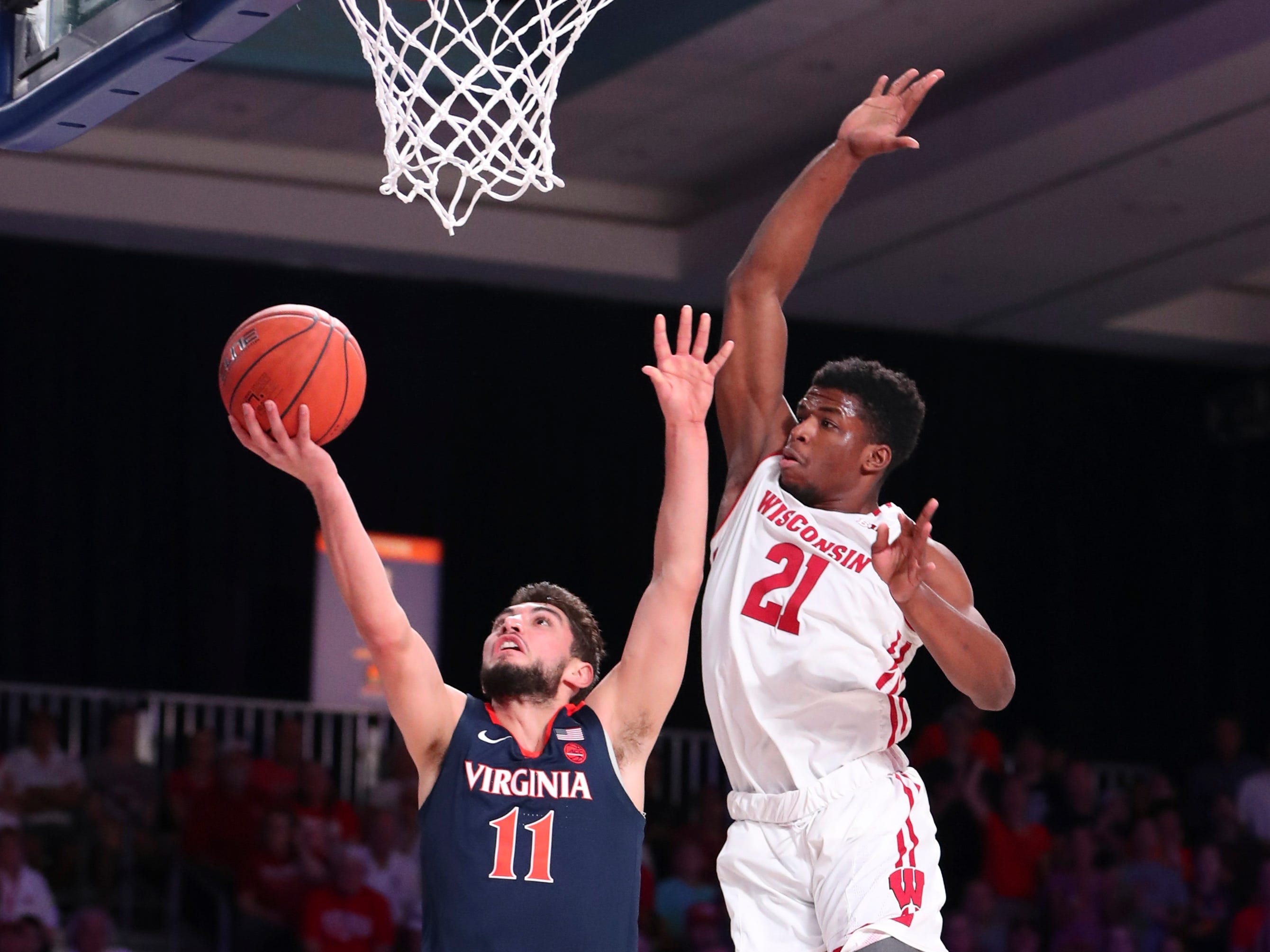 Virginia Cavaliers guard Ty Jerome gets past UW guard Khalil Iverson.