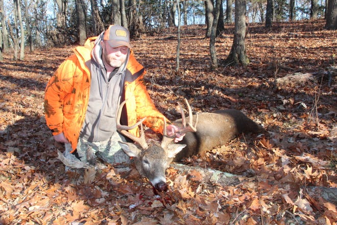 Greg Thiesen of Montello poses with a 9-point buck he shot Nov. 18 while hunting in Marquette County.