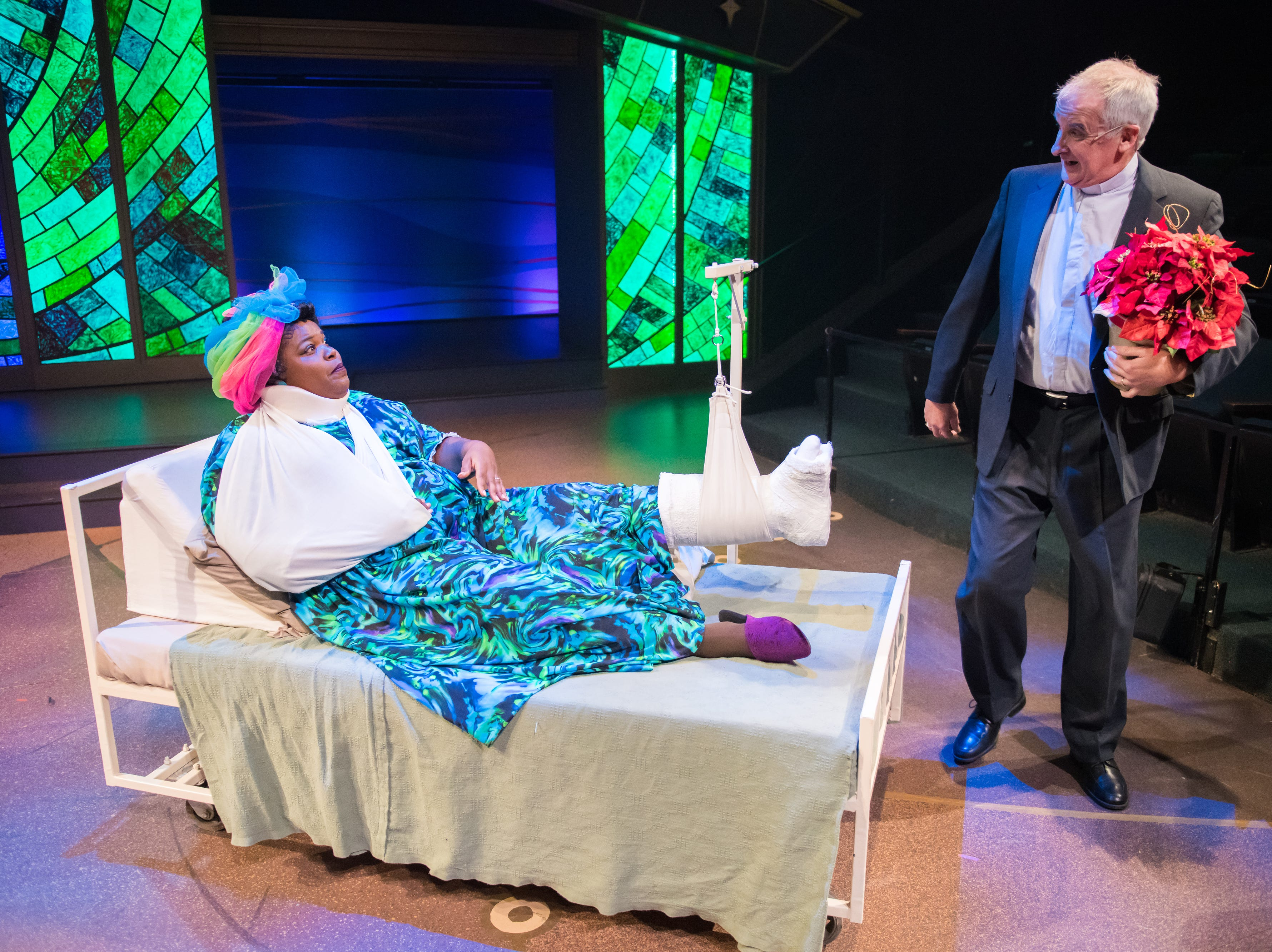"""Jonathan Gillard Daly visits the ailing Lachrisa Grandberry in """"The Best Christmas Pageant Ever: The Musical,"""" performed by First Stage."""