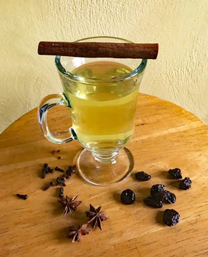 This spiced white winter glogg would be perfect to serve at a holiday happy hour.