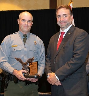 Lawrence County (Mo.) conservation officer Andy Barnes (left) and Southeastern Association of Fish and Wildlife Agencies President Chuck Sykes (right) pose for a photo after Barnes was named the 2018 Colonel Bob Brantley Wildlife Officer of the Year. Barnes, a 1998 graduate of Mountain Home High School, is also a two-time Missouri Conservation Agent of the Year.