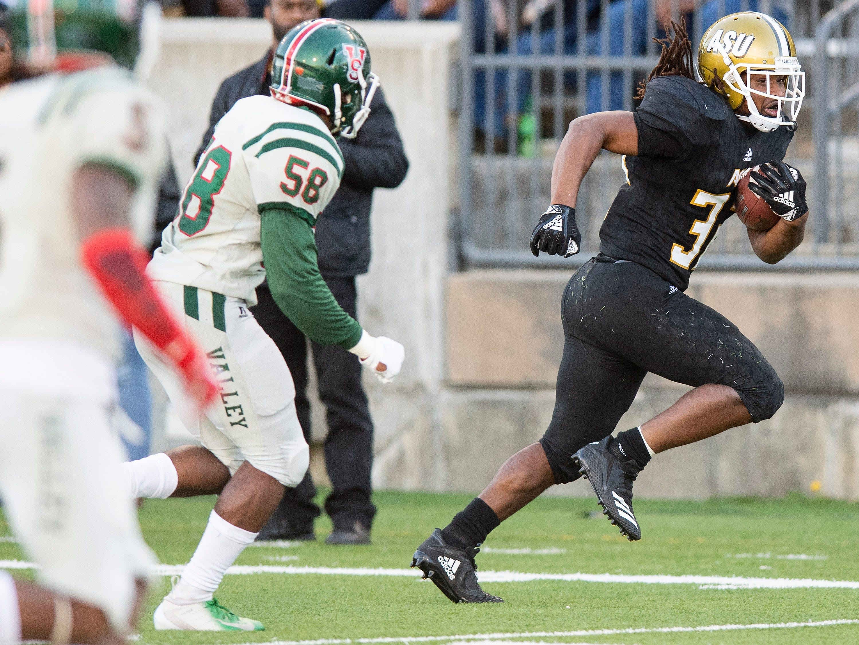 Alabama State University running back Tallesin Farmer (32)  carries the ball against Mississippi Valley State in first half action of the Turkey Day Classic at Hornet Stadium on the ASU campus in Montgomery, Ala., on Thanksgiving Day, Thursday November 22, 2018.