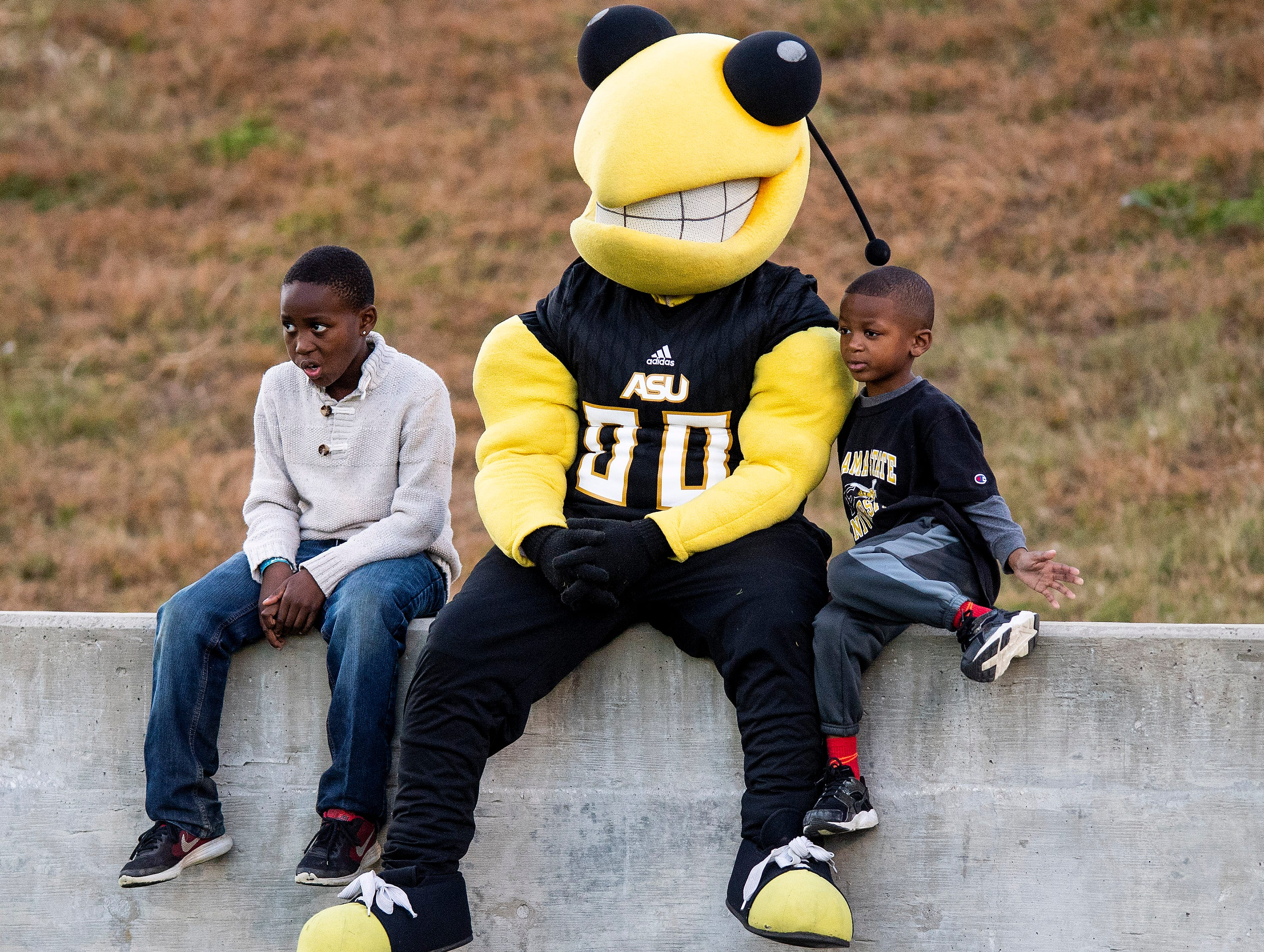The Alabama State University mascot sits with young fans during the Turkey Day Classic at Hornet Stadium on the ASU campus in Montgomery, Ala., on Thanksgiving Day, Thursday November 22, 2018.