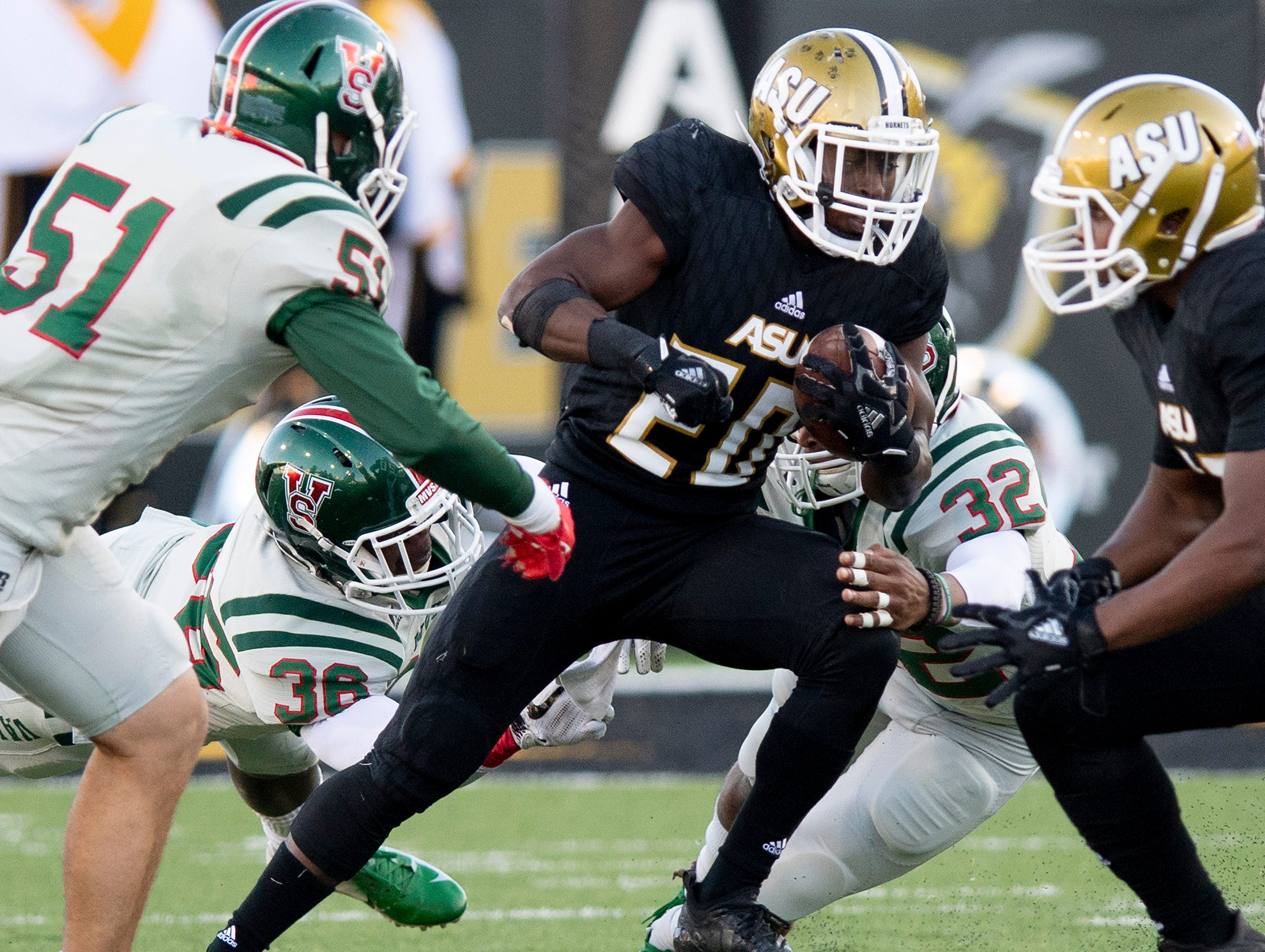 Alabama State University running back Ezra Gray (20) carries the ball against Mississippi Valley State in first half action of the Turkey Day Classic at Hornet Stadium on the ASU campus in Montgomery, Ala., on Thanksgiving Day, Thursday November 22, 2018.