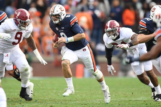 Auburn quarterback Jarrett Stidham (8) runs against Alabama at Jordan-Hare Stadium during the Iron Bowl on Nov. 25, 2017.
