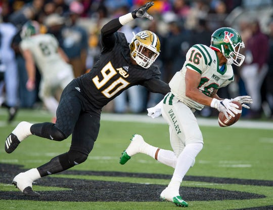 Alabama State University defensive lineman Lucky Oyovwi (90) sacks Mississippi Valley State's Dejerric Bryant (16) in first half action of the Turkey Day Classic at Hornet Stadium on the ASU campus in Montgomery, Ala., on Thanksgiving Day, Thursday November 22, 2018.