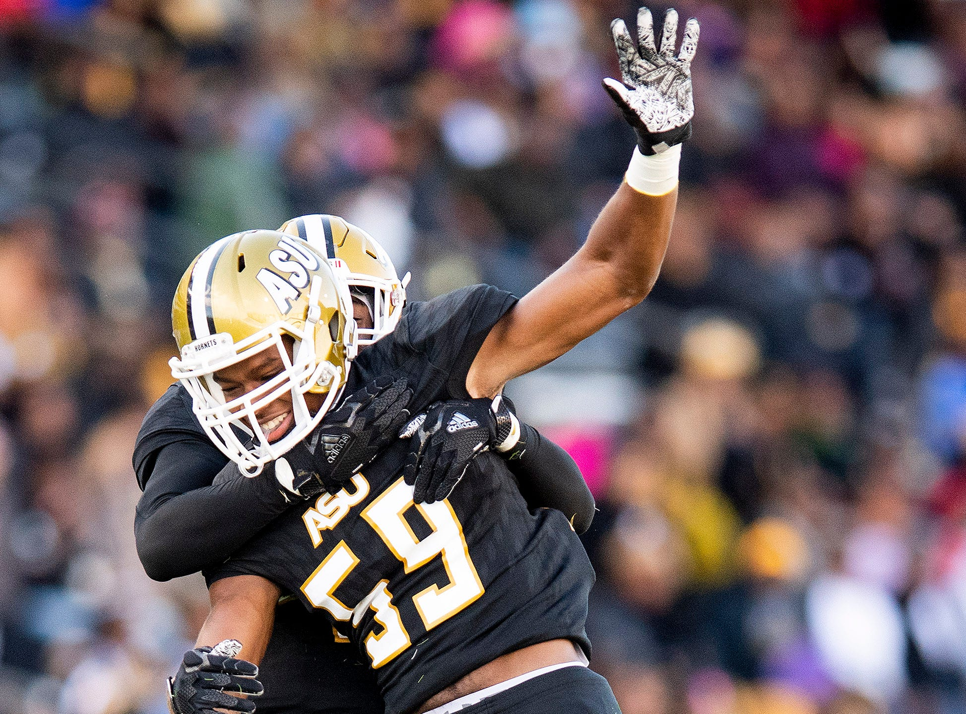 Alabama State University linebacker Abraham Adesipe (59)  celebrates sacking the Mississippi Valley State quarterback in first half action of the Turkey Day Classic at Hornet Stadium on the ASU campus in Montgomery, Ala., on Thanksgiving Day, Thursday November 22, 2018.