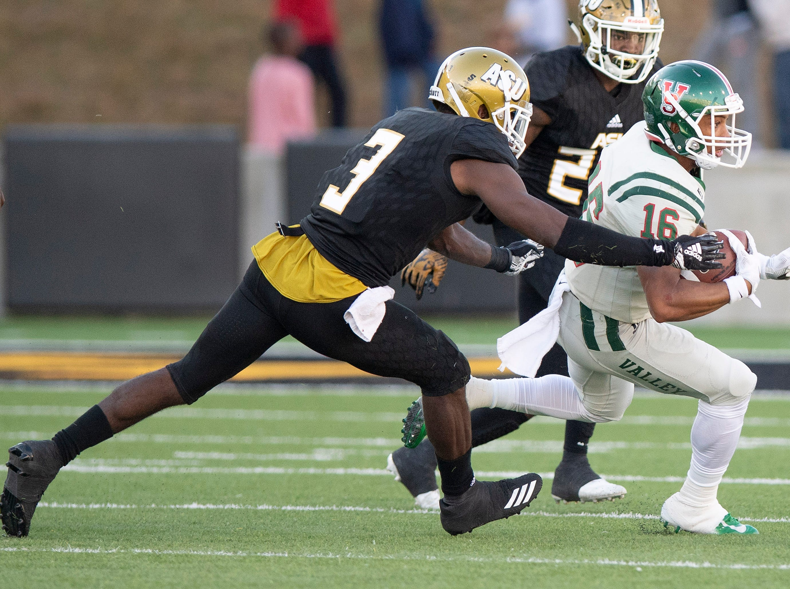 Alabama State University defensive back Dennis Roberts, IV, (3)  stoops Mississippi Valley State's Dejerric Bryant (16) in first half action of the Turkey Day Classic at Hornet Stadium on the ASU campus in Montgomery, Ala., on Thanksgiving Day, Thursday November 22, 2018.