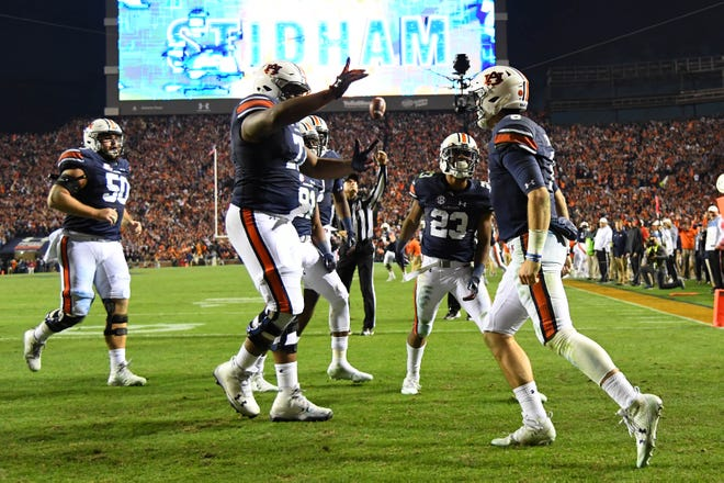 Auburn quarterback Jarrett Stidham (8) celebrates his rushing touchdown against Alabama during the fourth quarter of the Iron Bowl at Jordan-Hare Stadium on Nov. 25, 2017.