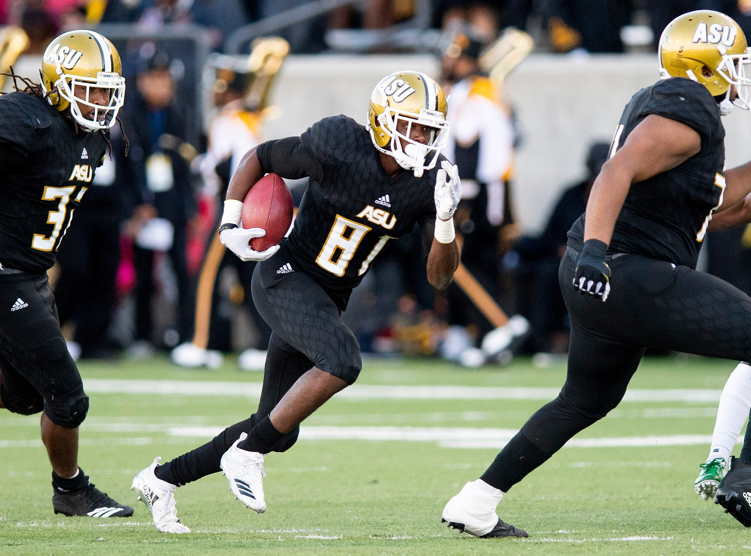 Alabama State University wide receiver Marquez Spencer (81) carries the ball against Mississippi Valley State in first half action of the Turkey Day Classic at Hornet Stadium on the ASU campus in Montgomery, Ala., on Thanksgiving Day, Thursday November 22, 2018.