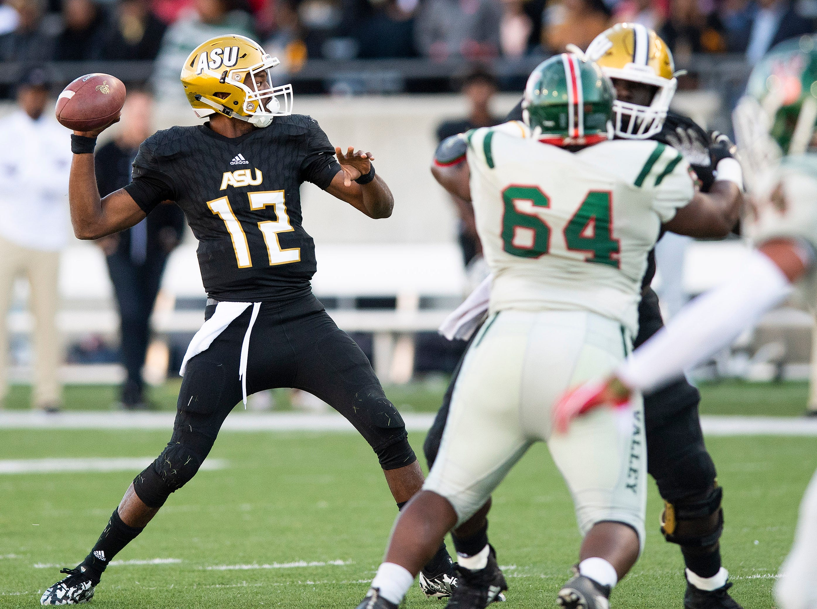 Alabama State University quarterback KHA'Darris Davis (12)  passes the ball against Mississippi Valley State in first half action of the Turkey Day Classic at Hornet Stadium on the ASU campus in Montgomery, Ala., on Thanksgiving Day, Thursday November 22, 2018.