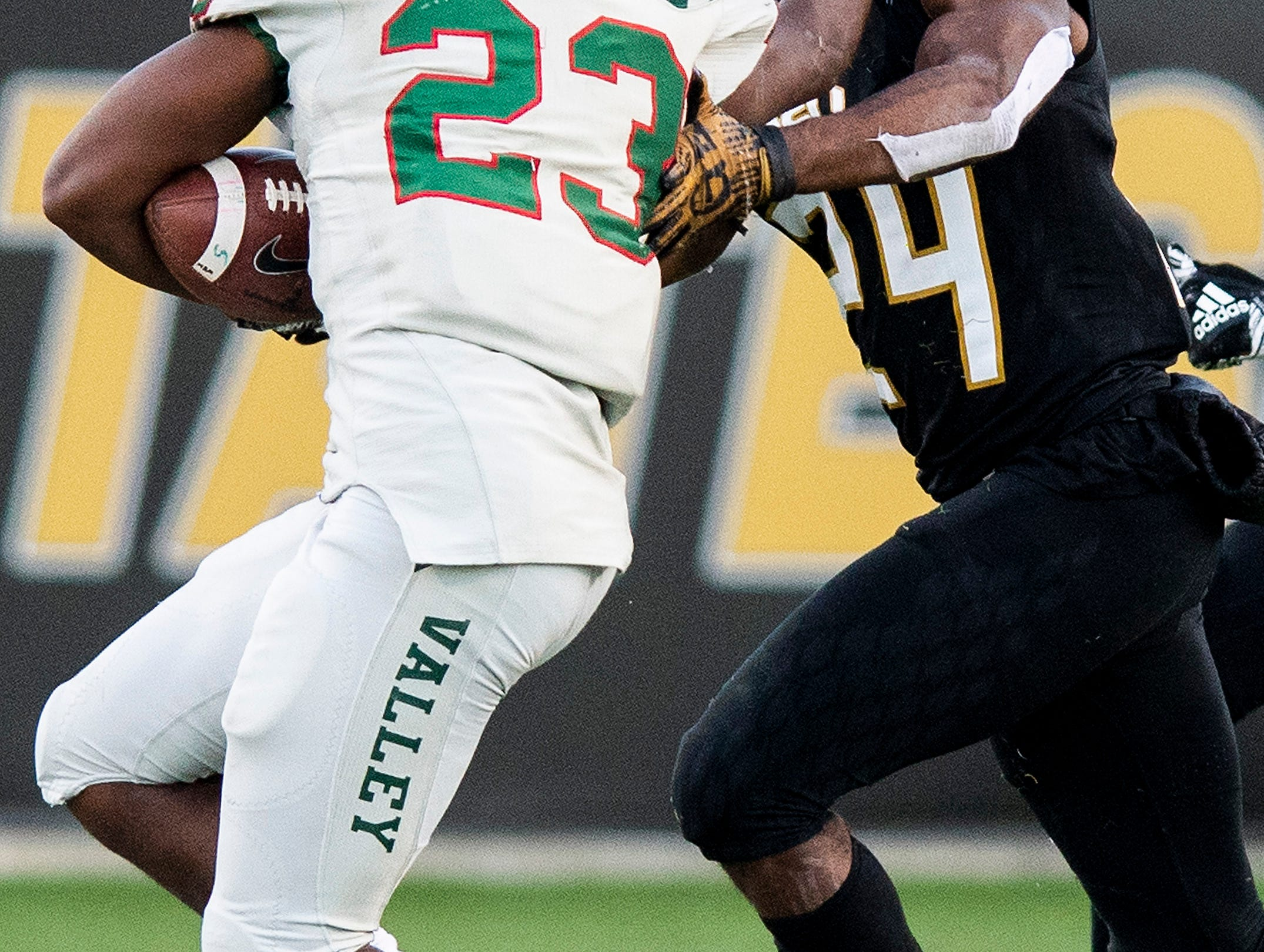 Mississippi Valley State running back John Derrick Smith (23)  stiff arms Alabama State University defensive back Joshua Hill (24) in the Turkey Day Classic at Hornet Stadium on the ASU campus in Montgomery, Ala., on Thanksgiving Day, Thursday November 22, 2018.