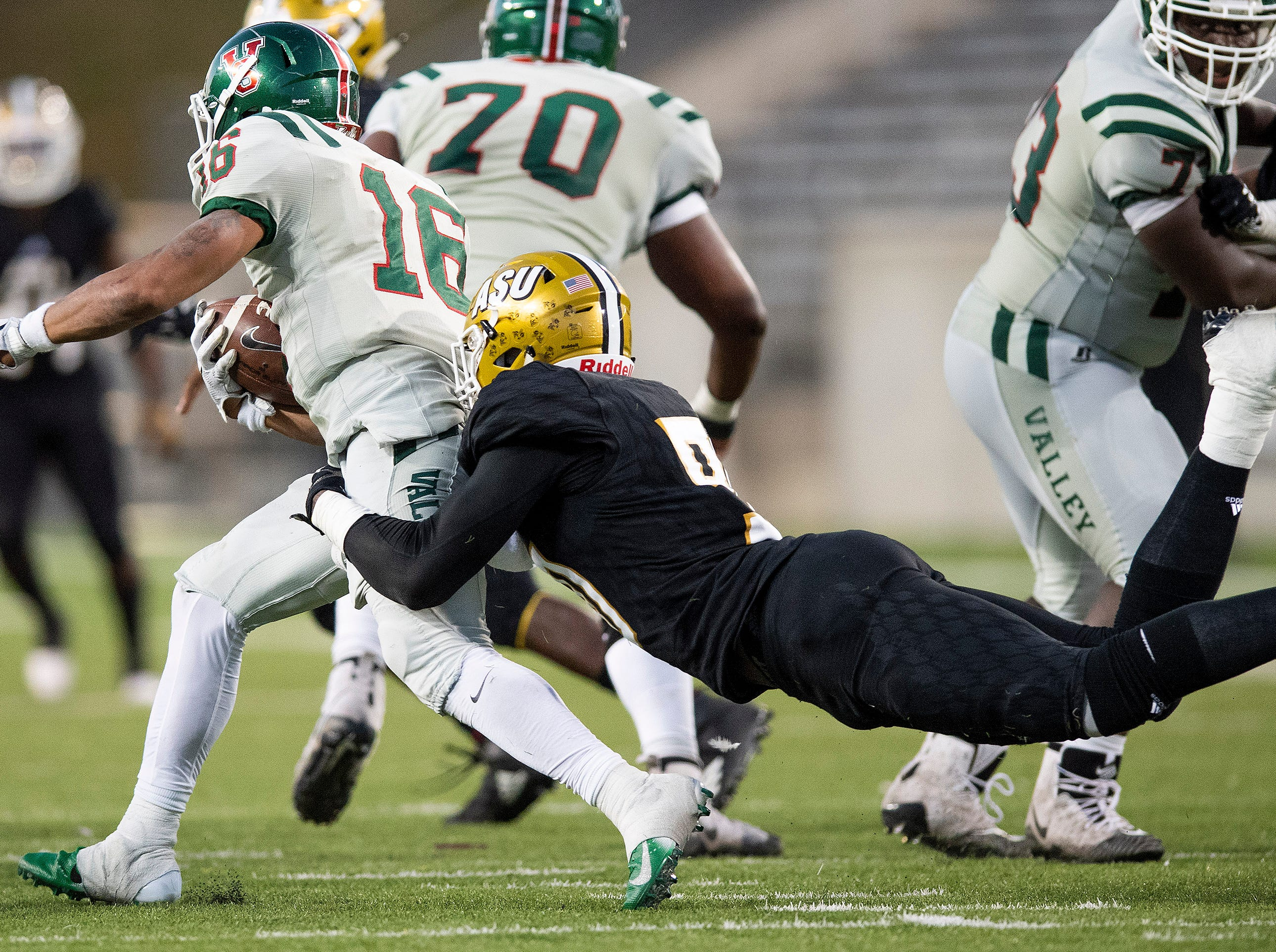 Alabama State University defensive lineman Lucky Oyovwi (90)  stops Mississippi Valley State's Dejerric Bryant (16) during the Turkey Day Classic at Hornet Stadium on the ASU campus in Montgomery, Ala., on Thanksgiving Day, Thursday November 22, 2018.