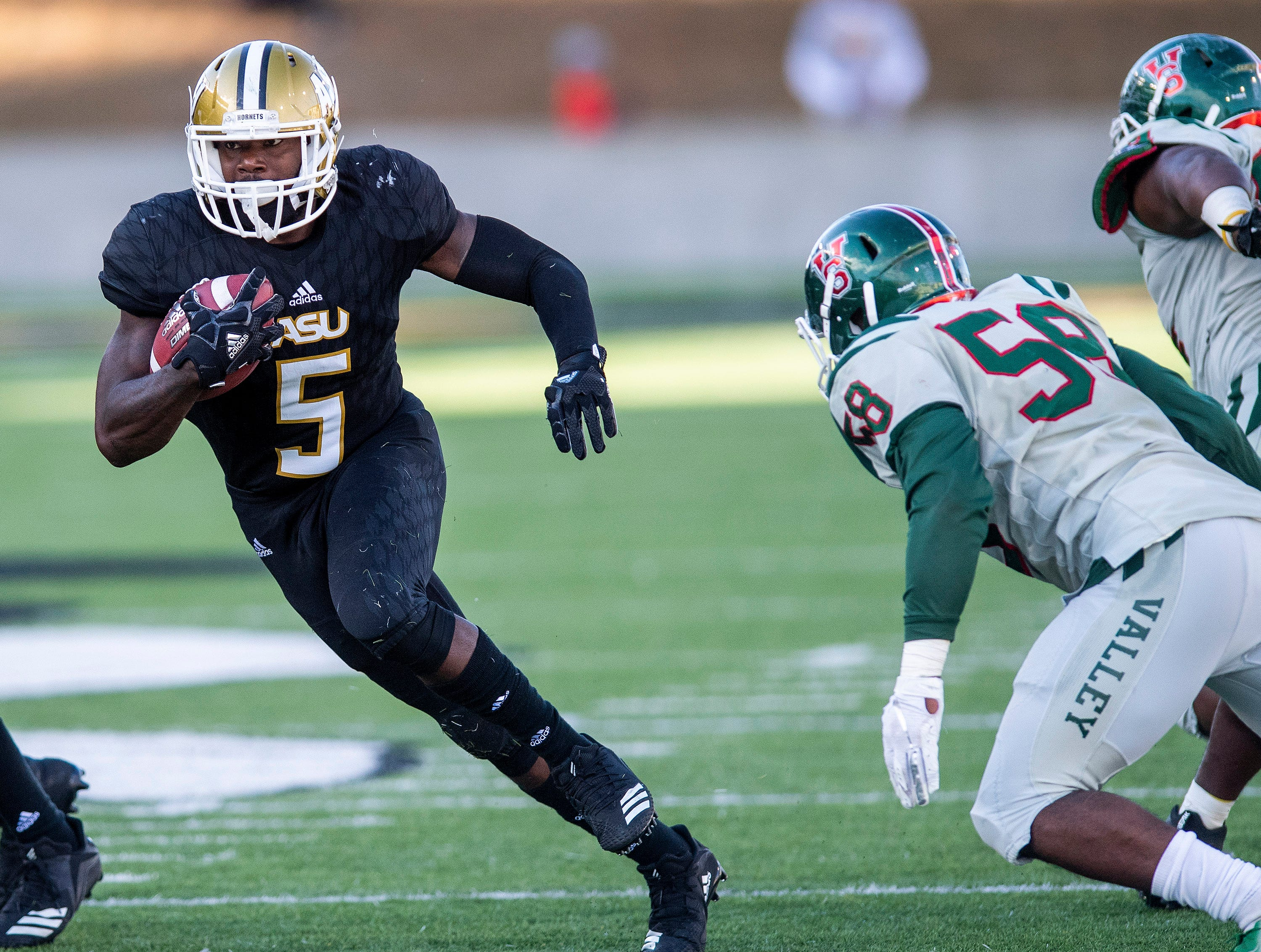Alabama State University running back Alex Anderson (5)  carries the ball against Mississippi Valley State
