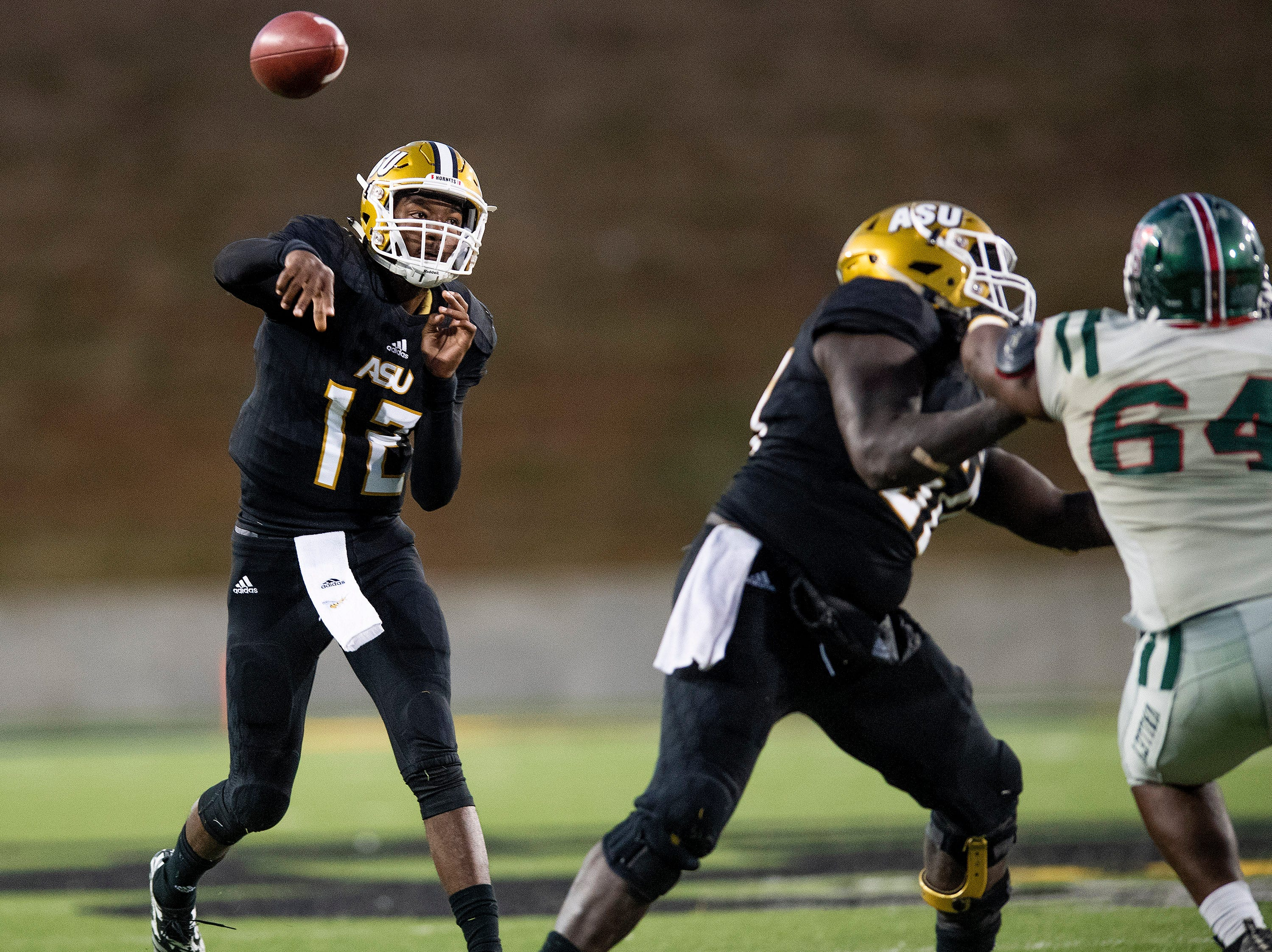 Alabama State University quarterback KHA'Darris Davis (12) passes against Mississippi Valley State the Turkey Day Classic at Hornet Stadium on the ASU campus in Montgomery, Ala., on Thanksgiving Day, Thursday November 22, 2018.