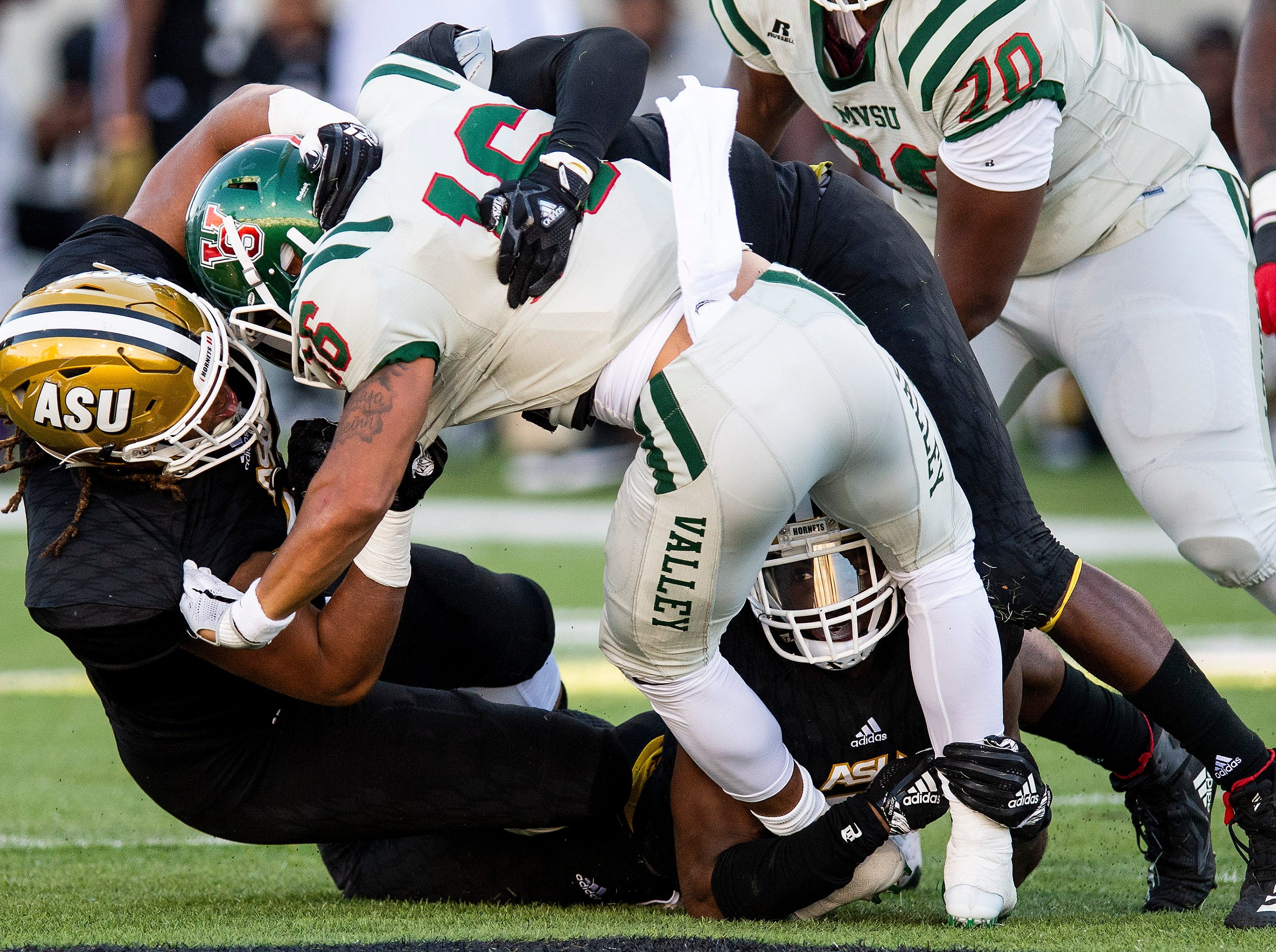 Alabama State University defensive lineman Randall Smith (77) and defensive lineman Trevor Goodrum (48)  stop Mississippi Valley State's Dejerric Bryant (16) in first half action of the Turkey Day Classic at Hornet Stadium on the ASU campus in Montgomery, Ala., on Thanksgiving Day, Thursday November 22, 2018.