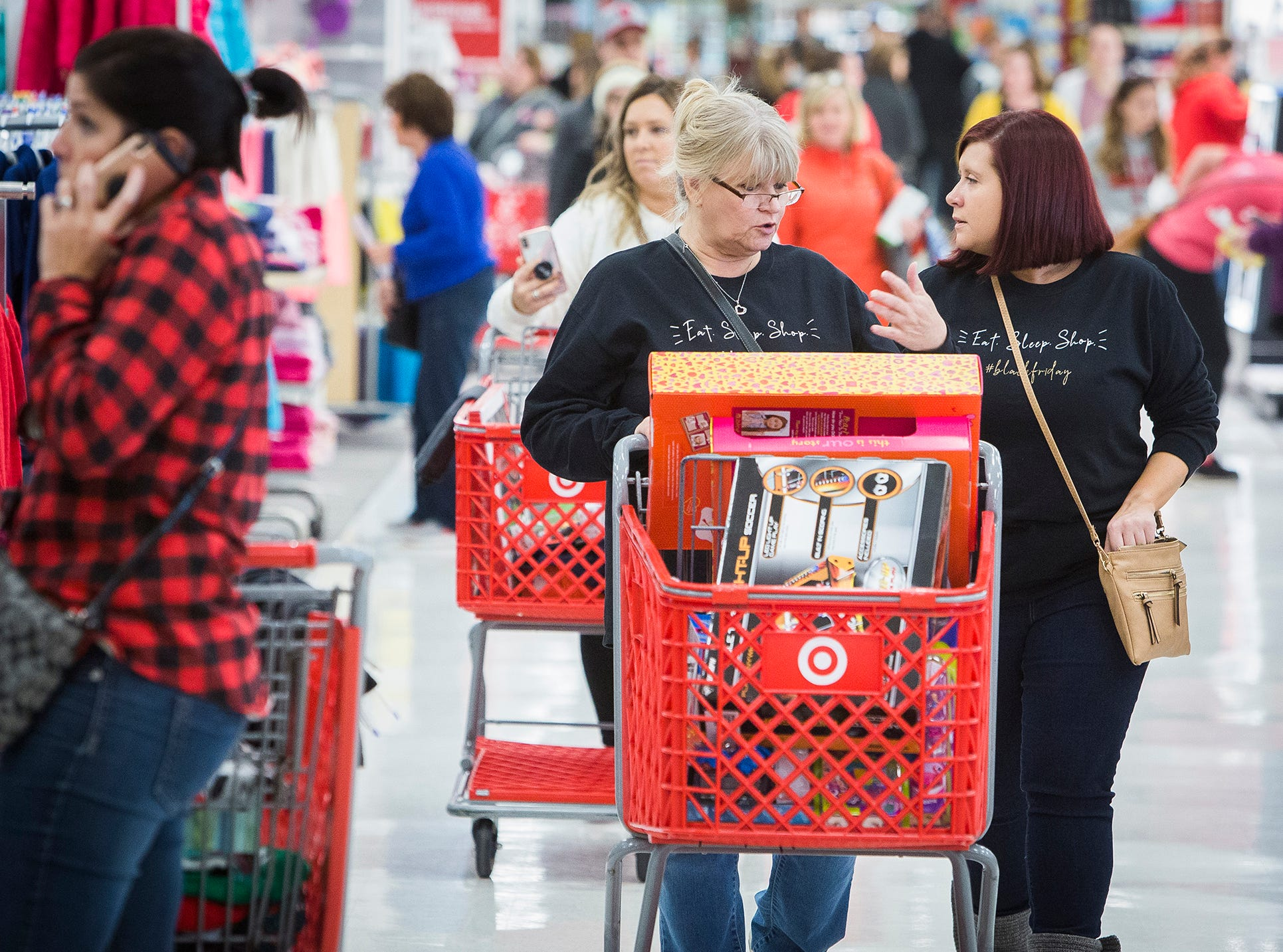 Customers shop at the Muncie Mall, Best Buy, Target and Menards on McGalliard Road during Black Friday.