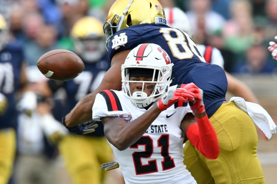 Ball State Cardinals cornerback Antonio Phillips (21) breaks up a pass intended for Notre Dame Fighting Irish tight end Alize Mack (86) in the first quarter Sep. 8, 2018 at Notre Dame Stadium.