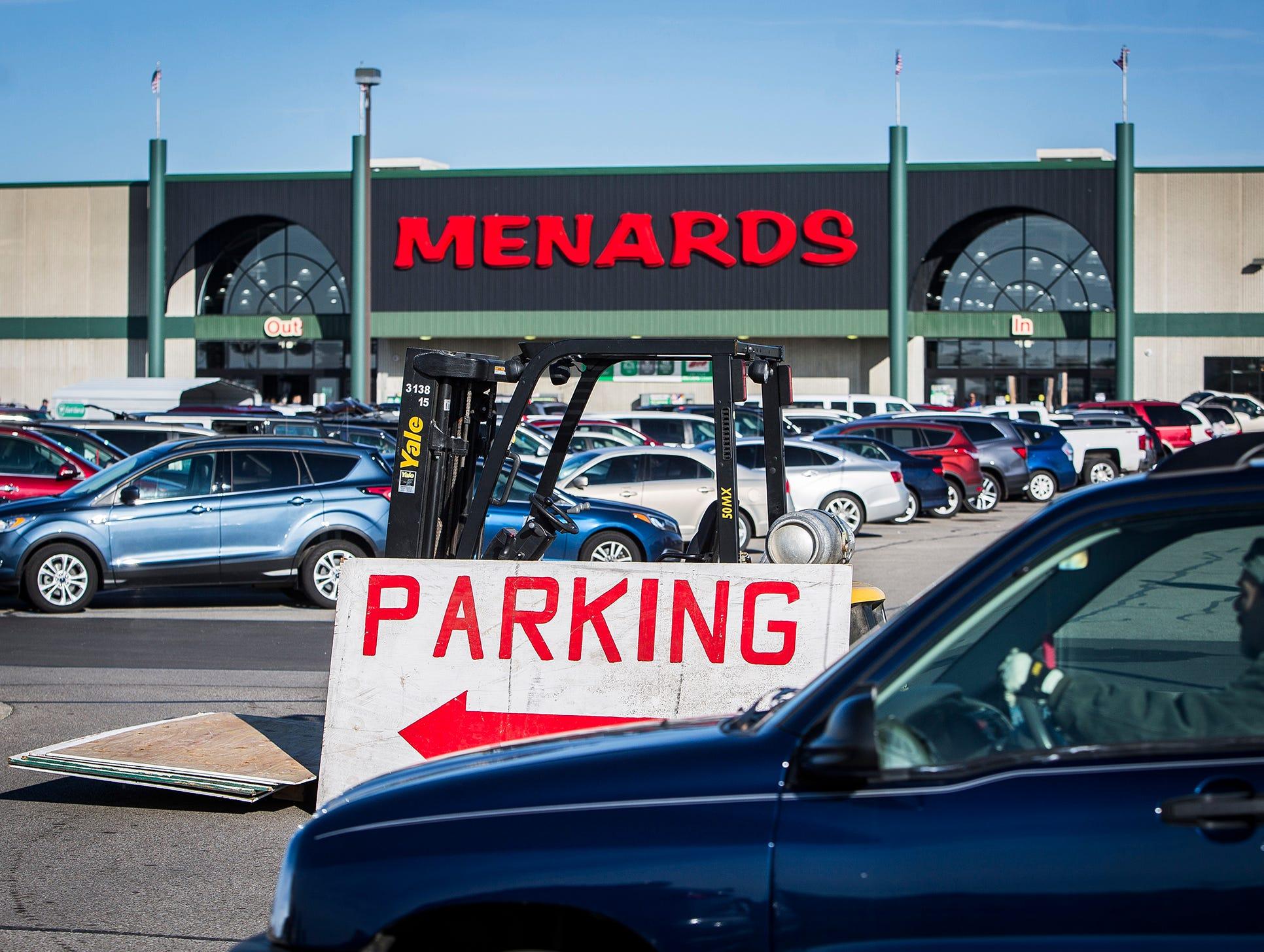 Cars fill the  Menards parking lot on Black Friday.
