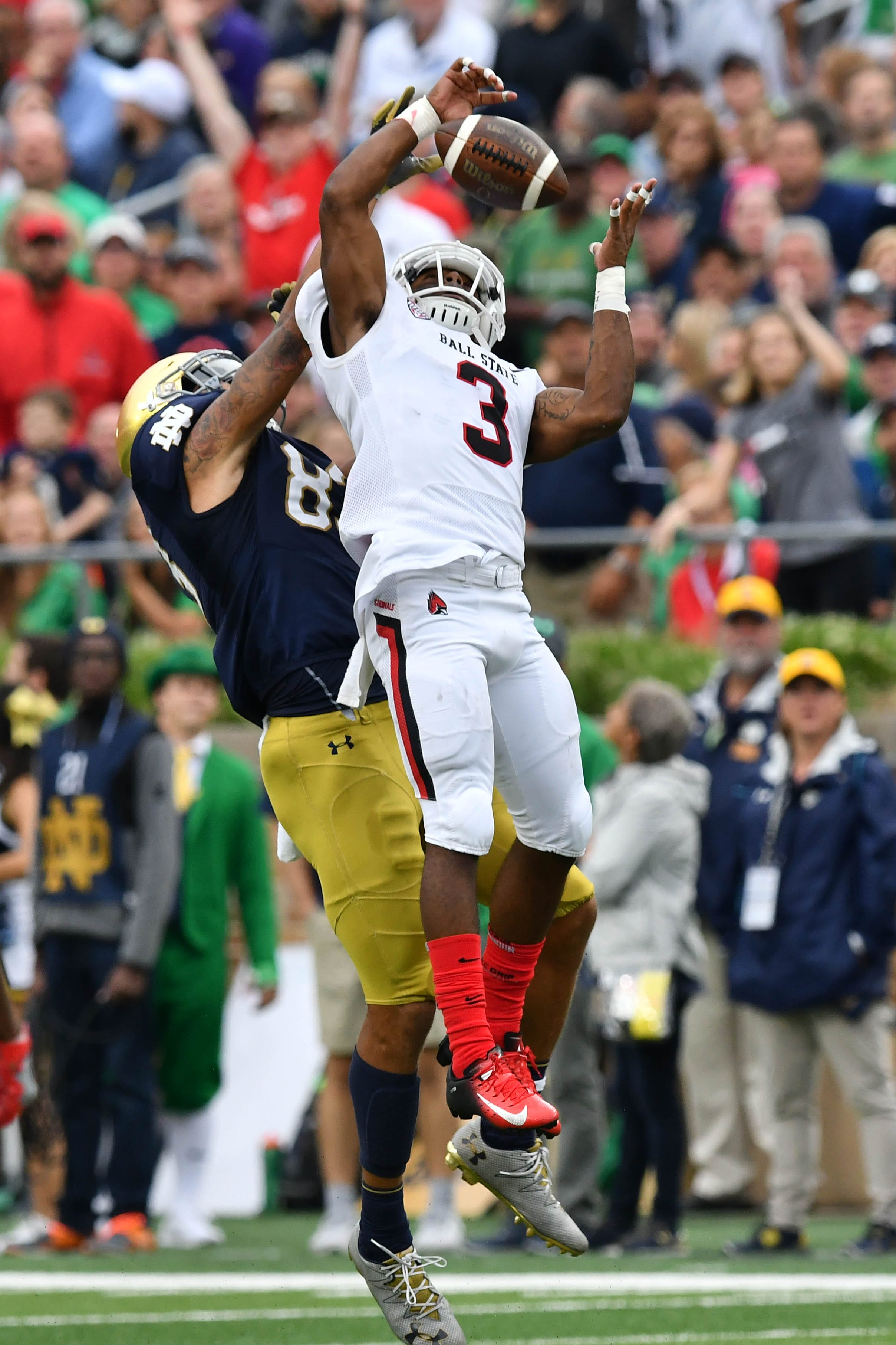 Ball State Cardinals cornerback Josh Miller (3) intercepts a pass intended for Notre Dame Fighting Irish wide receiver Chase Claypool (83) in the second quarter Sep. 8, 2018 at Notre Dame Stadium.