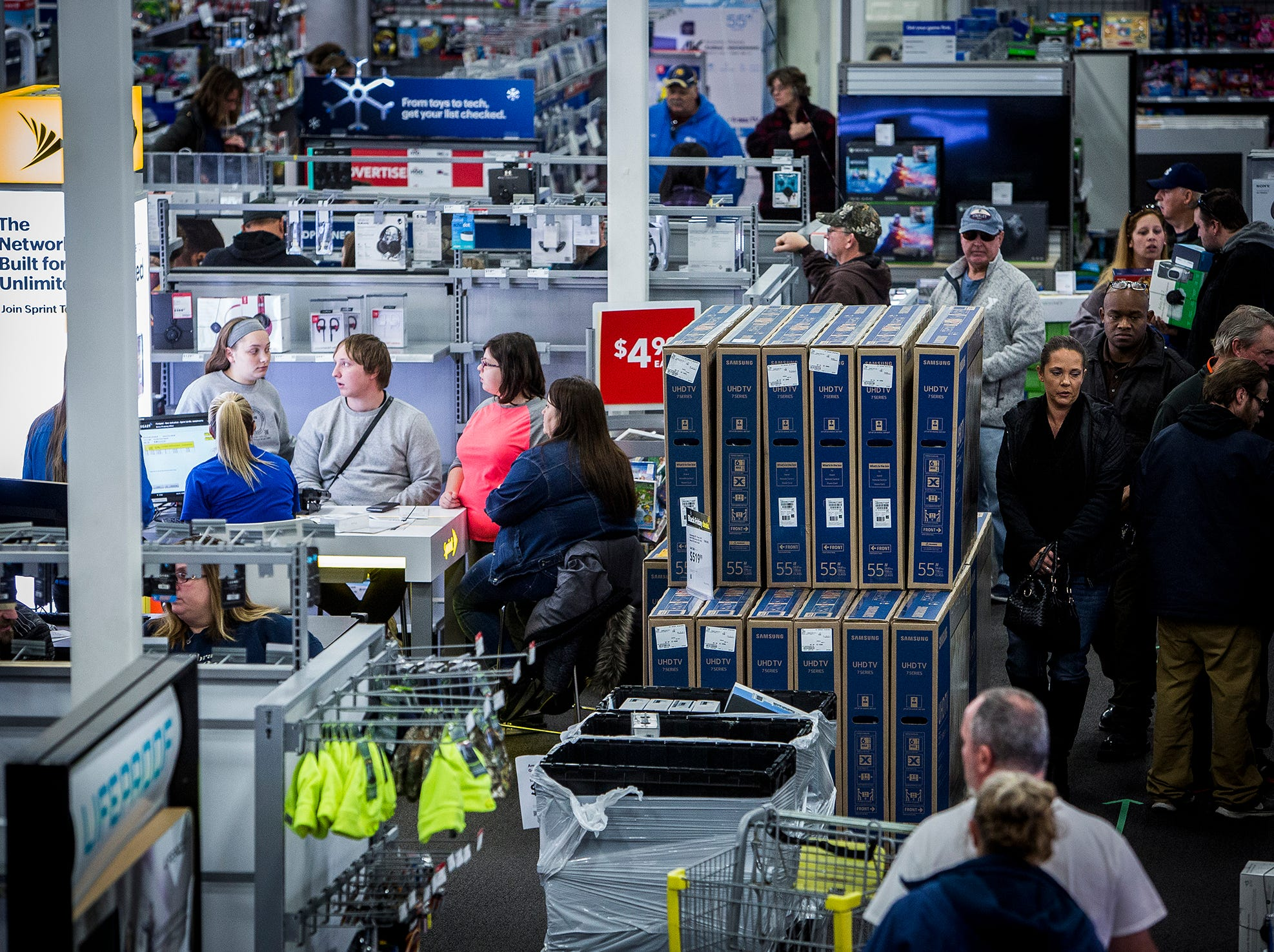 Customers fill the aisles at Best Buy during Black Friday.