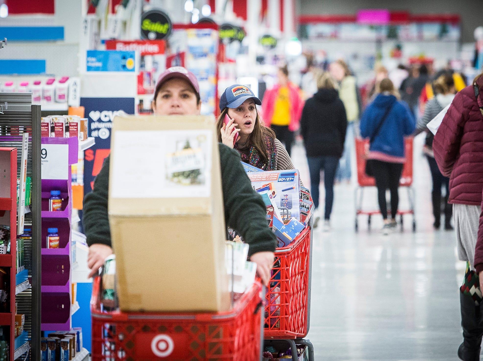 Shoppers take advantage of Black Friday deals at Target.