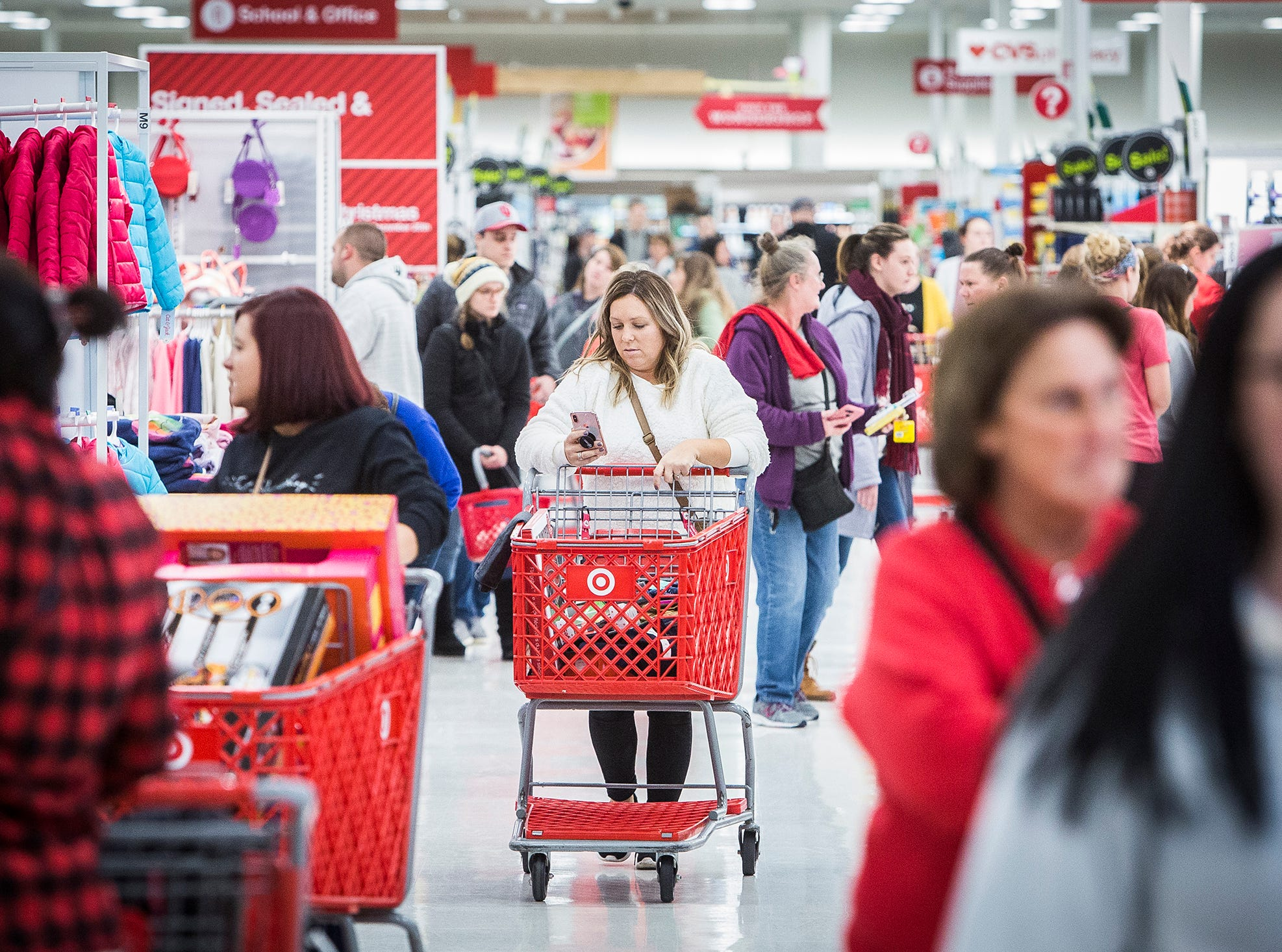 Shoppers crowd an aisle at Target on Black Friday.