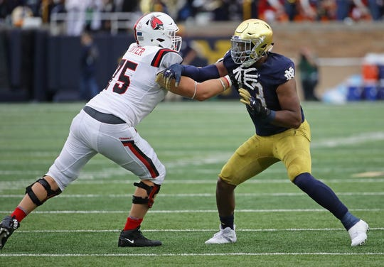 FILE -- Khalid Kareem #53 of the Notre Dame Fighting Irish rushes against Danny Pinter #75 of the Ball State Cardinals at Notre Dame Stadium on September 8, 2018 in South Bend, Indiana. Notre Dame defeated Ball State 24-16. (Photo by Jonathan Daniel/Getty Images)