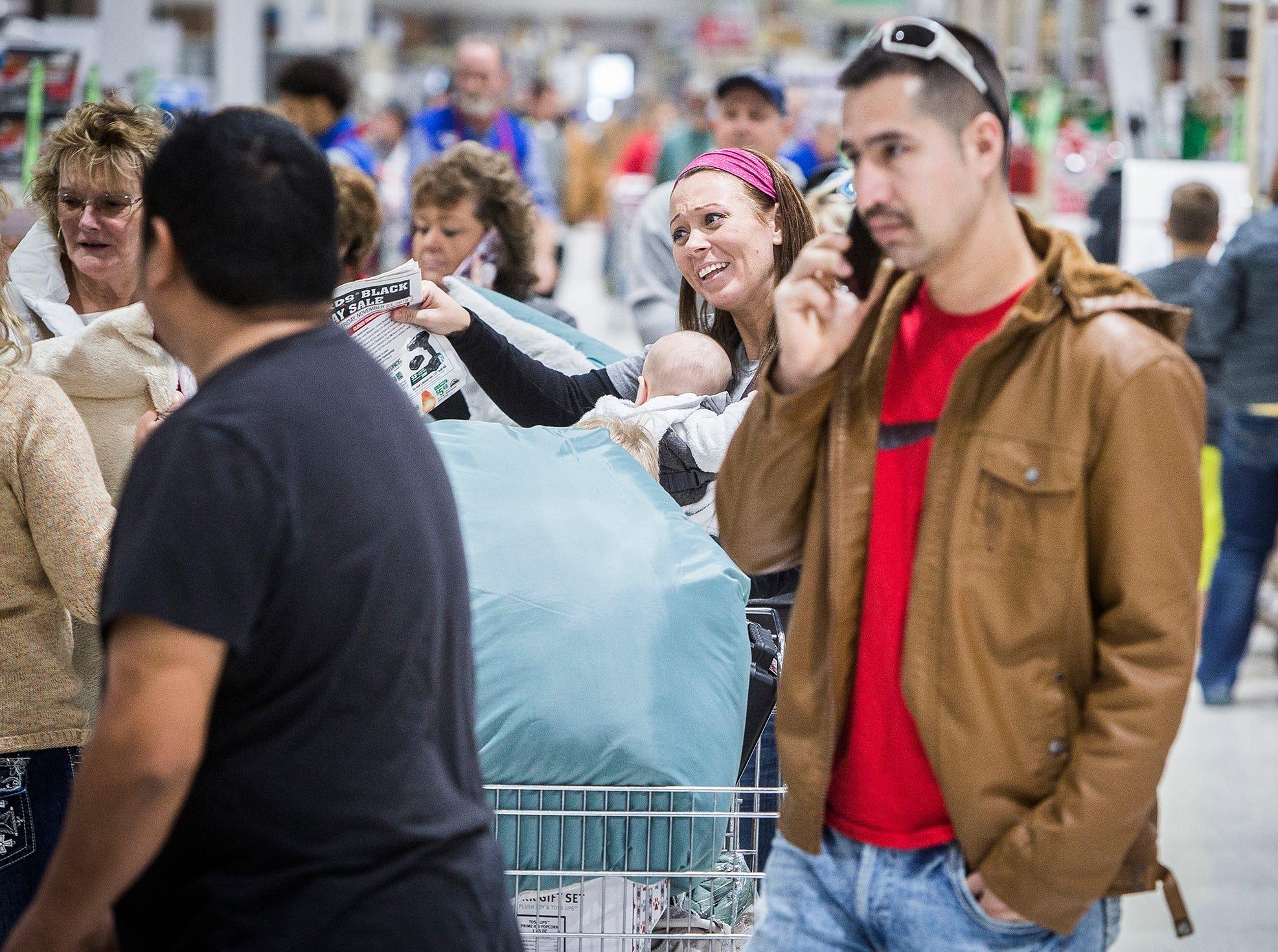 Shoppers visit Menards on Black Friday.