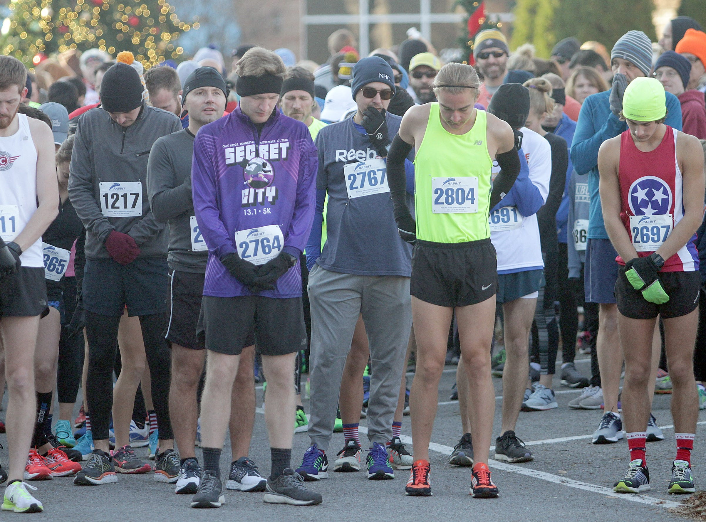 Runners pray before the Indian Lake Loop 2018 benefiting COMPASS on Thanksgiving Day at The Streets of Indian Lake.