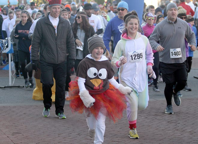 Even young runners got in the turkey spirit for the Indian Lake Loop 2018 benefiting COMPASS on Thanksgiving Day at The Streets of Indian Lake.