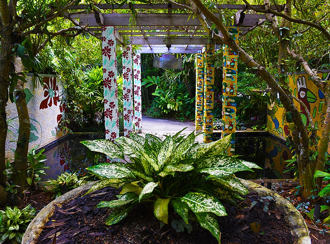The Naples Botanical Garden's Lea Asian garden pays homage to both new and old Asian garden design, featuring beautiful modern mosaics and carvings reflected in pools of water.
