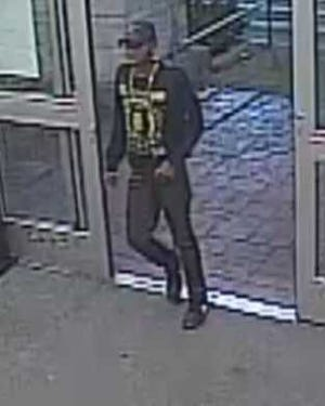 This surveillance photo shows a suspect, who authorities say is responsible for at least six smash-and-grab car burglaries in south Lee County.
