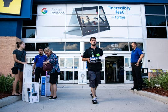 Customers come and go from the Naples Boulevard, Best Buy on Friday, Nov. 23, 2018, for their annual Black Friday sale.