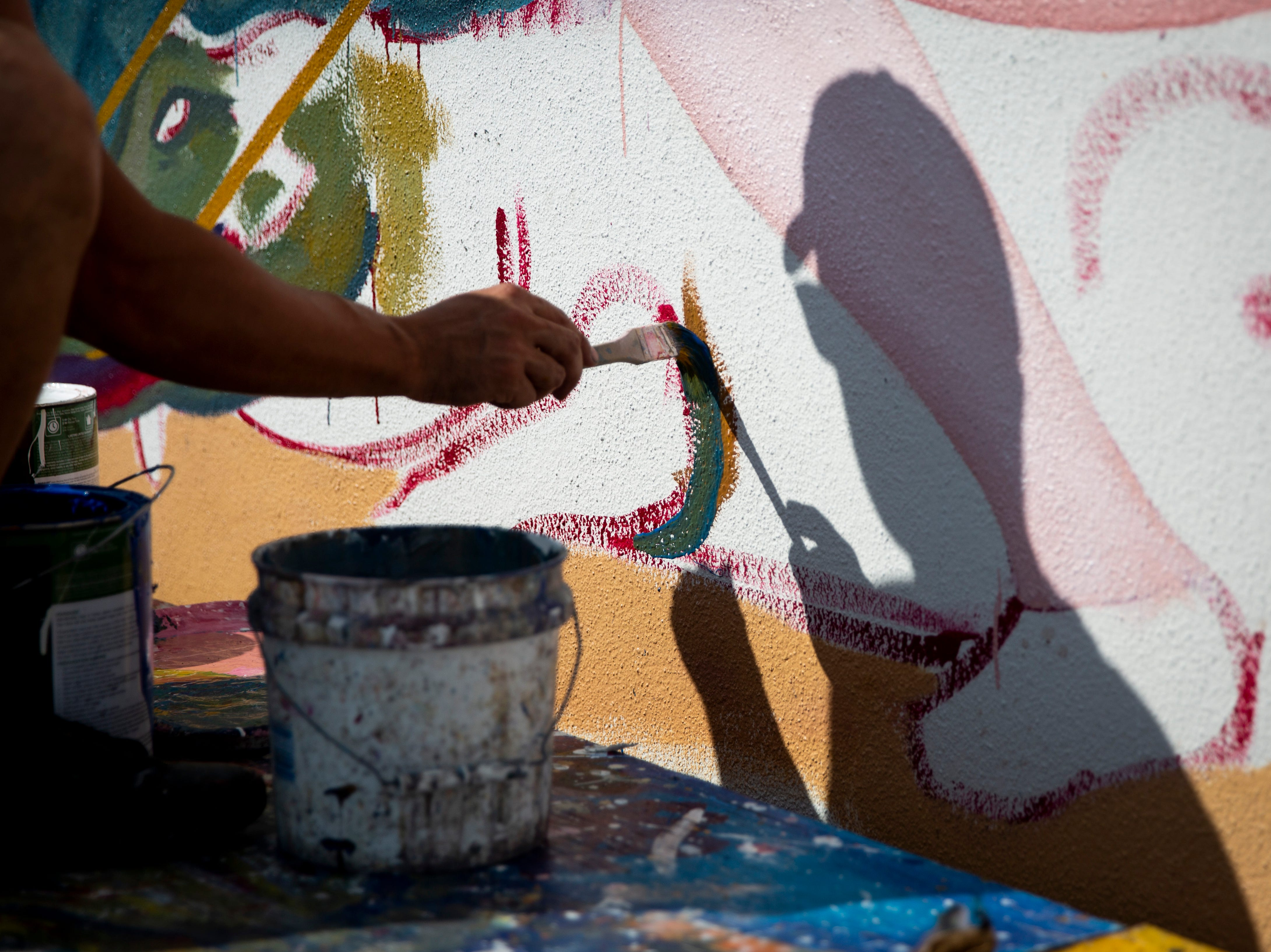 Naples artist Juan Diaz works on a mural on Friday, Nov. 23, 2018, at U.S. 41 South and First Avenue South in Naples. Diaz has been working on the mural for three weeks and plans to have it completed by Saturday.