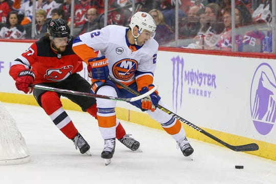 Nov 23, 2018; Newark, NJ, USA; New York Islanders defenseman Nick Leddy (2) controls the puck against New Jersey Devils center Pavel Zacha (37) during the second period at Prudential Center.