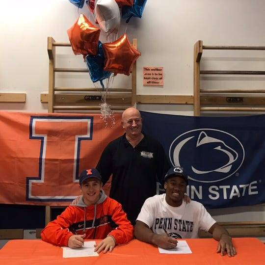 Cannon Johnson of Teaneck (right) signing to attend Penn State for men's gymnastics.