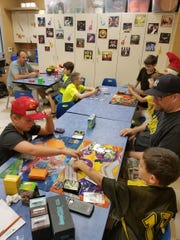 Gamers play the Pokémon Trading Card Game at the West Milford Library Pokémon Club. The club was recently started by 9-year-old Ben Romeo, left.