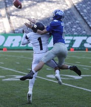 Empty seats can be seen in the background as Rutherford's Abellany Mendez defends a pass in the North Group 2 Bowl Game at MetLife Stadium.