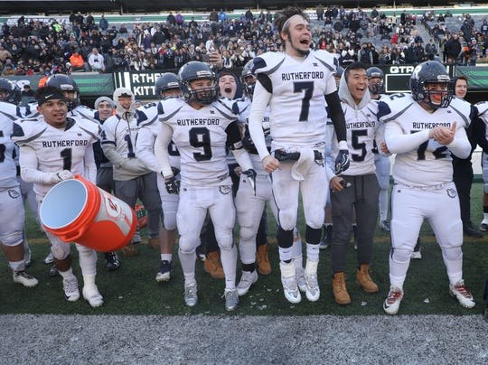 The Rutherford sideline reacts after their head coach Andrew Howell got his with the Gatorade shower near the end of the game.