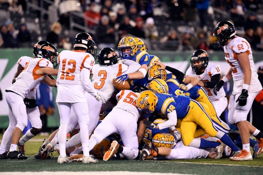 The Hasbrouck Heights defense stops Butler one yard short of a touchdown in the second half. Heights won 41-7 for the North Group 1 title on Friday, Nov. 23, 2018, in East Rutherford.