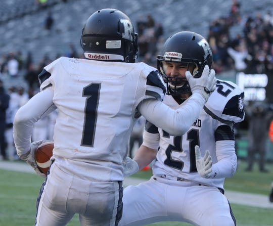 Abellany Mendez of Rutherford celebrates one of his four touchdowns, with team mate Connor Cahill.