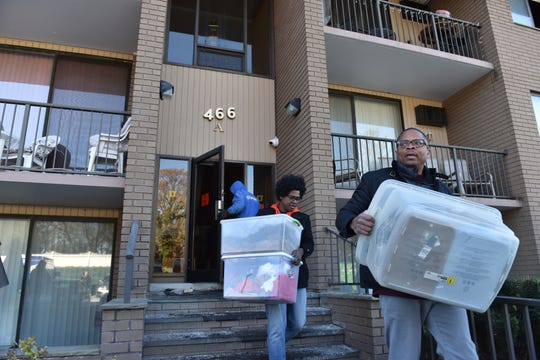 Residents clear out their belongings after a fire broke out on Thanksgiving night at an condominium complex on Liberty St in Little Ferry on Friday morning November 23, 2018. 24 units were forced to evacuated since the utilities were cut from the building.