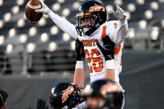 Hasbrouck Heights' Michael Robertson (26) is lifted by a teammate in the endzone after scoring the first touchdown of the game.  Heights defeats Butler 41-7 for the North Group 1 title on Friday, Nov. 23, 2018, in East Rutherford.