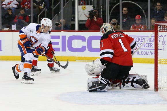 Nov 23, 2018; Newark, NJ, USA; New York Islanders defenseman Thomas Hickey (4) shoots the puck at New Jersey Devils goaltender Keith Kinkaid (1) during the first period at Prudential Center.
