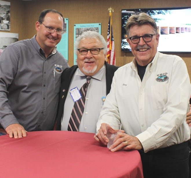EBID District Engineer Zack Libbin, left, Doña Ana County Commissioner Raymundo Gonzalez, and EBID Manager/Treasurer Gary Esslinger celebrate the district's 100th anniversary during a recent open house.