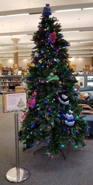 The Mitten Tree at Thomas Branigan Memorial Library.