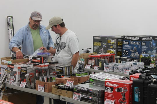 John Burns and Nathan Loiselle browsed through the several items during Harbor Freight's Black Friday sales.