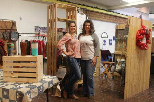 Morgan Foley and Jennifer Foust were hoping for a high volume of business at their Small Town Famous kiosk at the White Sands Mall during Black Friday.