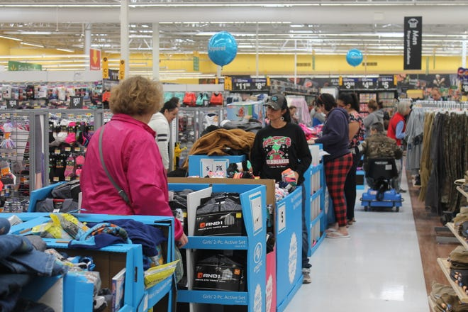 Alamogordo Wal-Mart shoppers browse through several items during the stores Black Friday sales.